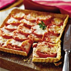 This Southern Living tomato & gruyere  tart is a staple on my Christmas Eve buffet.. It is delicious! saj