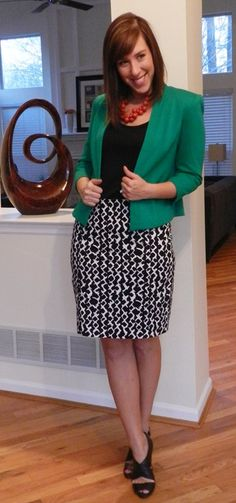 Graphic print skirt with a black shirt and teal blazer = great office look!