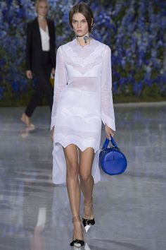 Christian Dior | Spring 2016 Ready-to-Wear | 19 White long sleeve mini dress with sheer panels and asymmetrical hem