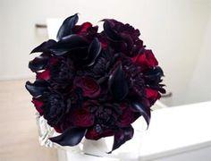 purpleand red roses arrangements | Dark purple flowers mimic the look of black flowers Photo: Michael ...