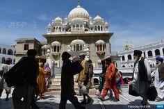 PAKISTAN, HASAN ABDAL: Sikh pilgrims arrive in Gurdwara  Panja Sahib, a shrine of the Sikh community's spiritual saint, in Hasan  Abdal, 48 kilometres from Rawalpindi, on April 11, 2015. Vaisakhi (also  spelled Baisakhi) is the festival to celebrate the founding of the Sikh  community known as the Khalsa. AFP PHOTO / Farooq NAEEM
