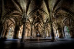 Arches, University of Glasgow. This cloister can be found between the two quadrangles of the main building at the University of Glasgow, Scotland.  Photography by Dave Wilson.