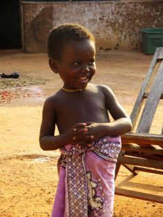 African Tribe People Village | Image of little girl in pink, rural Ghana, West Africa