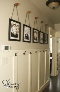Easy cheap DIY project to fill a big wall - no power tools needed. Frames on chains on finials. Wainscoting idea for bath.