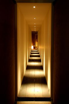 This hallway is an example of how lighting can really make an impact on the spacial quality of a room. Lighting plays a large role in the private entrance of Stacking Green Corridor Lighting, Interior Lighting, Home Lighting, Lighting Design, Lighting Ideas, Architecture Du Japon, Light Architecture, Interior Architecture, Flur Design