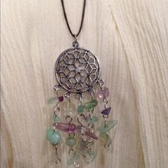Dream Catcher Adjustable Sliding Knit Necklace Hand made beaded dream catcher necklace. This can be worn long or short... just adjust the sliding knot!  This is perfect for layering because you can adjust these any length ( see last photo! ) Jewelry Necklaces