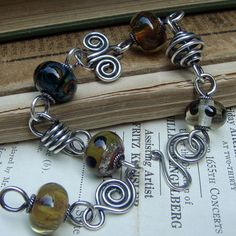 Willy Nilly wirework bracelet with neutral lampwork beads. cindywimmer.com