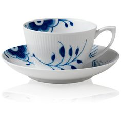 Royal Copenhagen's Blue Fluted Mega teacup and saucer are crafted of white fluted porcelain hand-painted with blue flowers. Part of the Blue Fluted Mega Collec…