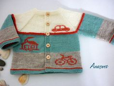 Baby cardigan in blue and white with application.This cardigan has top-down raglan construction and is worked in one piece.Hand embroidery..Knitting is soft and pleasant to the touch. length - 29,5cm/11,5  width -26,5cm/10,5  Size:6-12 m The design is AnaSwet.  Perfect for your little baby!  Skill Level: Easy. Attention! Patterns with Diagram! Conventional international symbols.   Use thinner yarn and smaller needles for a smaller sweater or thicker yarn and larger needles for a bigger one…