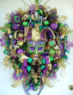 Mardi Gras Wreath.  Great use for extra xmas baubles, you could do the mask with art supply shop goodies..