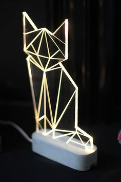 This cool geometric cat lamp. | 24 Adorable Products Every Cat Lover Needs In…