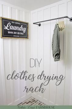 DIY Galvanized Pipe Clothes Drying Rack | This pipe clothes drying rack is an inexpensive way to add some instant character to your laundry room | #clothesdryingrack #laundryroomideas #galvanizeddecor #galvanizedpipeprojects via @cedarlanefarmhouse #Laundryroomimages