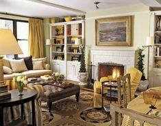 gemütliches-wohnzimmer-im-landhausstil - sofa mit vielen dekokissen und ein kamin - Die Wohnung im Landhausstil einrichten – 30 super Ideen