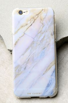 Protect your device all while displaying a cute design with The Casery Shatter Marble Blue and Pink iPhone 6 and 6s Case! This clear plastic case has a pink, blue, and beige marble print, flexible bumper edge, raised front (for extra screen protection), and access to all ports. Fits iPhone 6 and 6s.