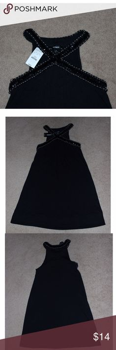 """Elegant Black and Silver Express Dress This dress will turn heads! It has black beading and silver stitching along the criss cross neck, and gathers under the bust creating small pleats as it flows down. MATERIAL - 95% polyester and 5% spandex. The dress is stretchy. MEASUREMENTS: Armpit to armpit 14"""", waist 29"""", hips 39"""", length 31"""". It is brand new with tags from Express and size XSmall. Express Dresses Mini"""