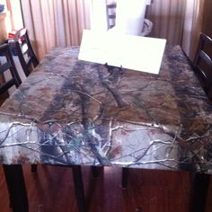 Camo Table cloth.. maybe over top of the glass living room table.
