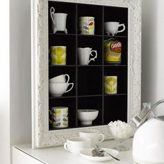 Mugs and storage in a frame, via Flickr.