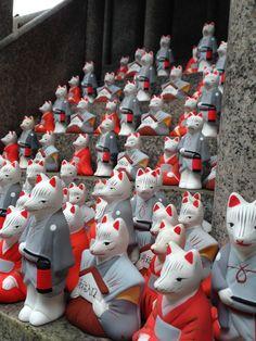 Small fox statues at Fushimiinari Shrine, Kyoto, Japan Copyright Mimi Yu