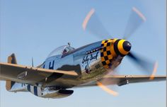 """North American P-51D Mustang """"Baby Duck"""" during a low pass."""