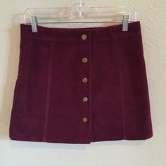 Top Shop Skirt Burgundy corduroy skirt in perfect condition from Topshop. I would recommend for a size 4-6. Topshop Skirts