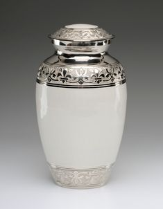White and silver cremation urn for ashes Caskets Direct Pty Ltd - White Enamel Cremation Ashes Urn, $230.00 (http://www.casketsdirect.com.au/products/white-enamel-cremation-ashes-urn.html)