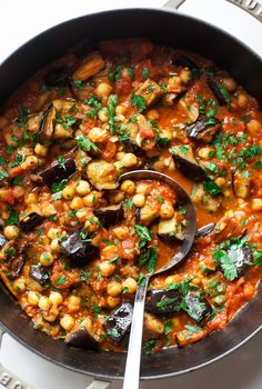BRAISED HARISSA EGGPLANT WITH CHICKPEAS - The First Mess Vegetarian Recipes Dinner, Vegan Eggplant Recipes, Recipes With Eggplant And Tomatoes, Eggplant Chickpea Recipe, Chickpea Recipes, Supper Recipes, Delicious Recipes, Vegetarian Cooking, Chickpea Meals