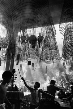 Rene Burri Saigon, Cholon, Chinese quarter. Chinese pagoda. Incense offering on New Year.