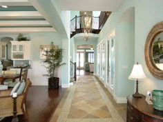 Contemporary Hallway: The contemporary hallway features mixed-media flooring that carries the eye through the rooms in the home. From HGTVRemodels.com
