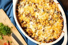 Weight Watchers Taco Casserole With Ground Chicken Breast, White Onion, Whole Kernel Corn, Black Beans, Taco Seasoning, Taco Sauce, Non-fat Sour Cream, Fat-free Shredded Cheddar Cheese, Fresh Tomatoes, Green Onions