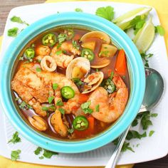 Caldo de Mariscos (Mexican Seafood Soup) Recipe Soups, Main Dishes with chopped onion, garlic, tomatoes with juice, water, chili powder, turnips, potatoes, carrots, bouillon cube, base, water, tilapia, shrimp, seafood, lime wedges, chopped cilantro, serrano, jalapeno chilies
