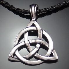 """Celtic Knot - Triquetra Trinity Pendant with 20"""" Necklace About The Triquetra: The original meaning of the word Triquetra is """"triangle"""" from the Latin tri- """"thr"""