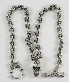 0f6201dac2bf Each link of Skull Necklace is a little fierce skull that suspend a large  skull pendant. We used sterling silver to give this item solid weight and  snazzy ...