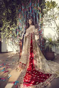 Top Pakistani Bridal Designers And Their Festive Wear Cost Gold bridal lehenga with maroon dupatta. Asian Bridal Dresses, Asian Wedding Dress, Pakistani Wedding Outfits, Indian Bridal Outfits, Pakistani Bridal Dresses, Pakistani Wedding Dresses, Bridal Lehenga, Bridal Dress Indian, Asian Bridal Wear