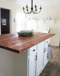 One of my most pinned photos on Pinterest is this picture of my sisters kitchen. We took 2 mismatched junk cabinets and fashioned them together (one was shorter than the other so it took some creative building). We finished it off with bead board and a wood top. Added some open shelving and white dishes and it's absolute farmhouse perfection! If you're on Pinterest, look me up! (The willow farmhouse) You can see the before and after on my blog. Search DIY kitchen island!! The transformation…