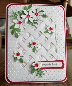 handmade card ... white with accents of red and green .. trellis of crossed paper strips ... punch flowers and folliage ... bright and crisp look ...