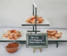 Succulent jumbo shrimp with a savory roasted tomato sauce is served during cocktail hour.