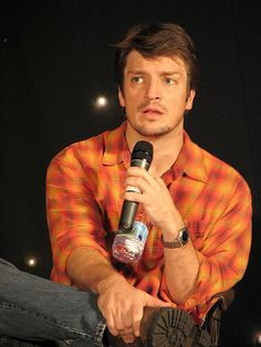 Nathan Fillion. A man of multiple personalities and apparently lips of satin.