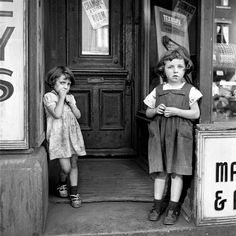 Children in a doorway in Canada.   18 Captivating Photos By The Mysterious Nanny-Photographer Of The Mid-Century