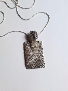 Handmade Prometheus Clay Pendant by Sonya Deevy