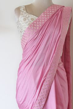 Saree is attire which offers you complete shape and because of which it makes women look amazing. On the festive occasions, Saree worn with right accessories can make you look really enthralling.This Saree is made from Paper Silk Georgette and which is le Indian Attire, Indian Outfits, Indian Wear, Pearl Work Saree, Simple Sarees, Stylish Sarees, Georgette Sarees, Banaras Sarees, Kota Sarees