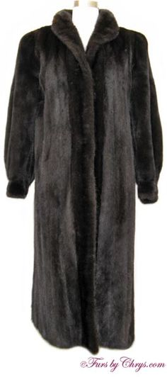 Ranch Mink Coat #RM743; $1800.00; Excellent Condition; Size range: 4 - 8. This is a gorgeous genuine natural female ranch mink fur coat. It has a Giorgio Sant'Angelo - Robert Sidney label and features a small shawl collar; bloused sleeves ending in banded, bracelet cuffs; and light padding at the outer shoulder edges. A copy of a recent appraisal showing the present retail value to be $9400 will be included with your purchase. This ranch mink coat is what dreams are made of!