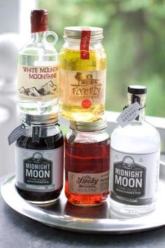 Moonshine cocktails! White Mountain Moonshine, FireFly Moonshine Apple Pie Flavor, Midnight Moon Moonshine, Ole Smoky Tennessee Moonshine Blackberry, and Midnight Moon Blueberry