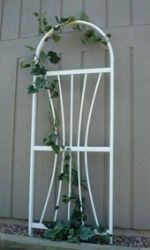 "Trellises: Grapevine Arch PVC Trellis  This PVC Trellis Grapevine Arch has an overall Size of 28"" wide x 75"" high7/8 x 1"" legs & cross rails5/8"" Tubes7/8 x 1"" arch top12"" ground anchorsAssembly Required"