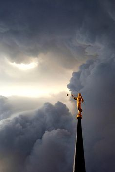 Most LDS Temples have this statue or one like it on the spire. It's the Angel Moroni, one of the ancient prophets told about in the Book of Mormon. To learn more about the Angel Moroni, contact the missionaries for a free copy of the Book of Mormon.