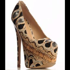 """BNIB Snake Print Platform Heels Walk on the wild side in the Athena. Featuring a 3 warm colorful colors with various snake prints throughout, almond toe, scooped vamped, hidden platform, and stiletto heel. finished with lightly padded insole and easy slip on style.   Brand: Liliana Heel Height: 6.5  Platform: 2"""" Hidden Material: Faux Leather Fits True to Size Liliana Shoes Platforms"""