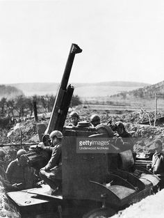 French soldiers man an anti-aircraft gun to discourage German reconnaissance planes in the vicinty of the Maginot line, France, April 5, 1940.