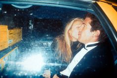John and Carolyn share a New York City Taxi. March 11, 1996.