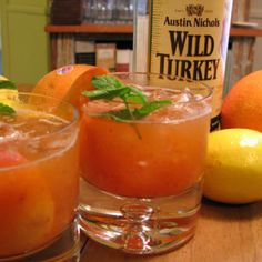 Whiskey Peach Smash, a really smooth drink that involves muddled peach, lemon, and mint, shaken with whiskey and served on the rocks. This is a good refreshing summer whiskey drink.