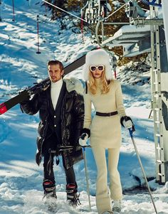 Vika Falileeva hits the slopes in white knitwear with fur hat