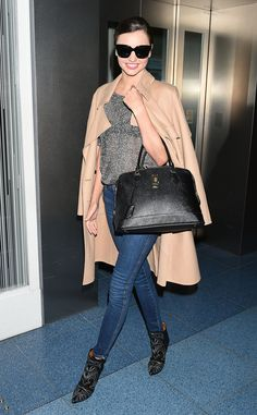 Kerr took the jeans and T-shirt look to new heights, by dressing up her marble gray style and skinny denim with a trench coat worn on the shoulders, pointed-toe heel boots, and leather bowler bag hanging on the crook of her arm.   - HarpersBAZAAR.com